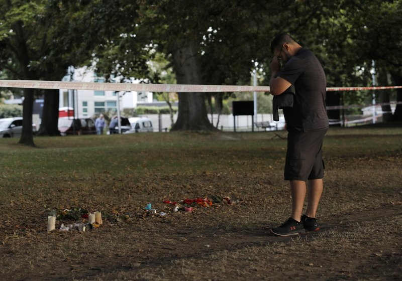 A man pays respects at the Al Noor mosque at a park in Christchurch, New Zealand, Wednesday, March 20, 2019. (AP Photo/Vincent Yu)