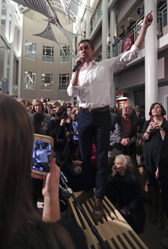Former Texas congressman Beto O'Rourke stands on a bench as he addresses a gathering during a campaign stop at Keene State College in Keene, N. (AP Photo/Charles Krupa)