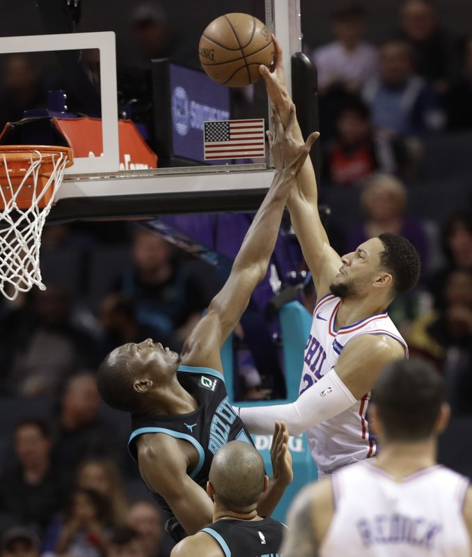 Philadelphia 76ers' Ben Simmons (25) is fouled by Charlotte Hornets' Bismack Biyombo (8) during the first half of an NBA basketball game in Charlotte, N. (AP Photo/Chuck Burton)
