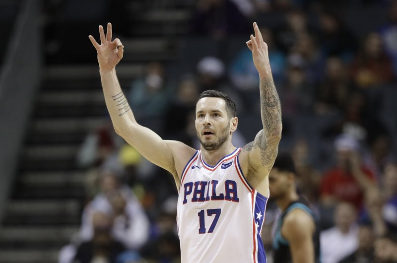 Philadelphia 76ers' JJ Redick (17) reacts after making a 3-point basket against the Charlotte Hornets during the first half of an NBA basketball game in Charlotte, N. (AP Photo/Chuck Burton)