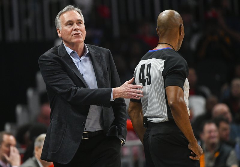Houston Rockets coach Mike D'Antoni pats referee Tom Washington on the back after the hawks are called for a foul during the second quarter of an NBA basketball game Tuesday, March 19, in Atlanta. (AP Photo/John Amis)