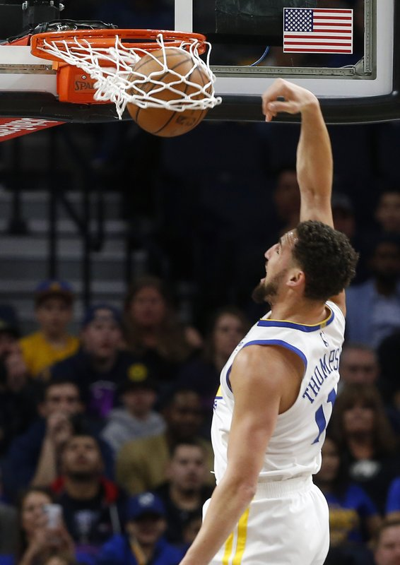 Golden State Warriors' Klay Thompson dunks against the Minnesota Timberwolves in the first half of an NBA basketball game Tuesday, March 19, 2019, in Minneapolis. (AP Photo/Jim Mone)
