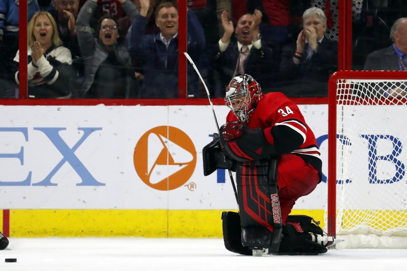 Carolina Hurricanes goaltender Petr Mrazek (34) celebrates his shoot out win over the Pittsburgh Penguins, Tuesday, March 19, 2019, in Raleigh, N. (AP Photo/Karl B DeBlaker)