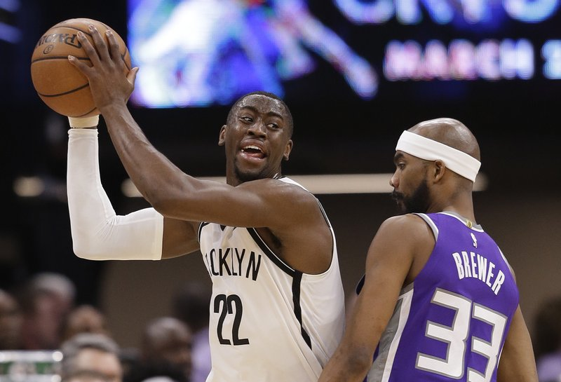 Brooklyn Nets guard Caris LeVert, left, protects the ball from Sacramento Kings guard Corey Brewer during the first quarter of an NBA basketball game Tuesday, March 19, 2019, in Sacramento, Calif. (AP Photo/Rich Pedroncelli)