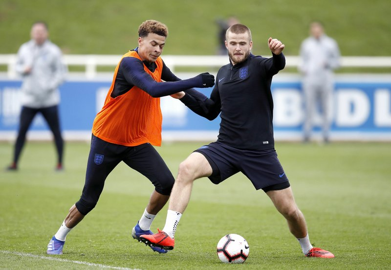 England's Dele Alli, left, and Eric Dier during a training session for England soccer team at St George's Park in Burton, England, Tuesday March 19, 2019. (Martin Rickett/PA via AP)
