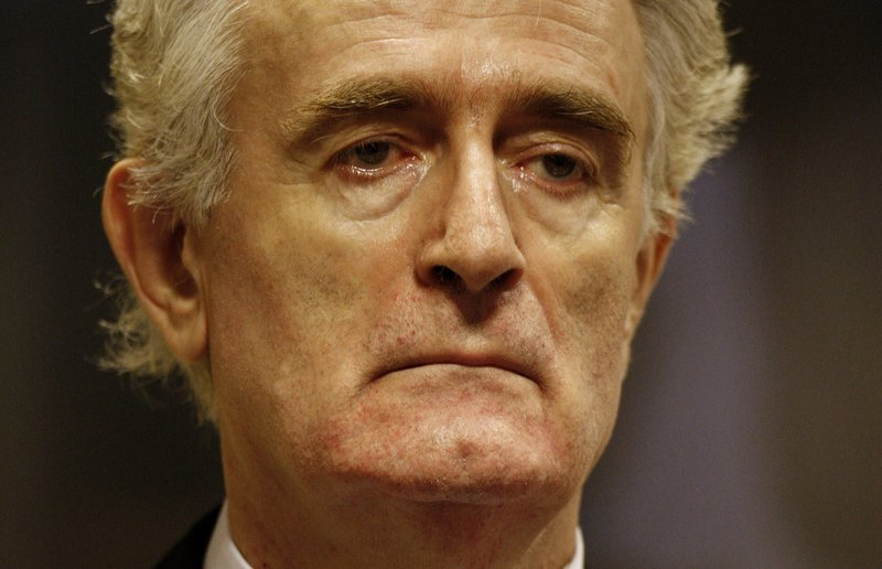 FILE - In this Thursday July 31, 2008 file photo, former Bosnian Serb leader Radovan Karadzic stands in the courtroom during his initial appearance at the U. (Jerry Lampen/Pool via AP, File)