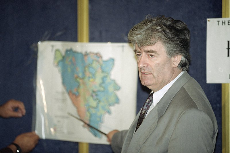 FILE - In this Aug. 25, 1992 file photo, Radovan Karadzic, Bosnian Serb leader in Bosnia-Herzegovina, indicates the Serb territories in Yugoslavia during a news conference in London. (AP Photo/Denis Paquin, File)