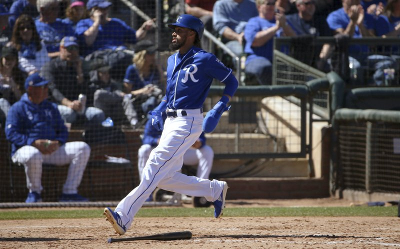 Kansas City Royals' Billy Hamilton scores against the Cleveland Indians during the second inning of a spring training baseball game Wednesday, March 13, 2019, in Surprise, Ariz. (AP Photo/Ross D. Franklin)