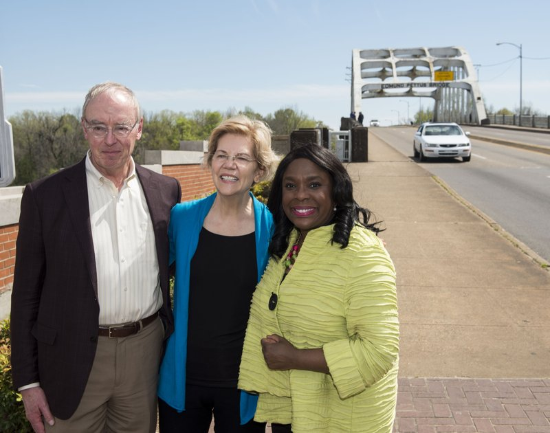 Democratic presidential candidate Sen. Elizabeth Warren, D-Mass., poses with her husband, Bruce Mann, left, and Rep. (Jake Crandall/The Montgomery Advertiser via AP)