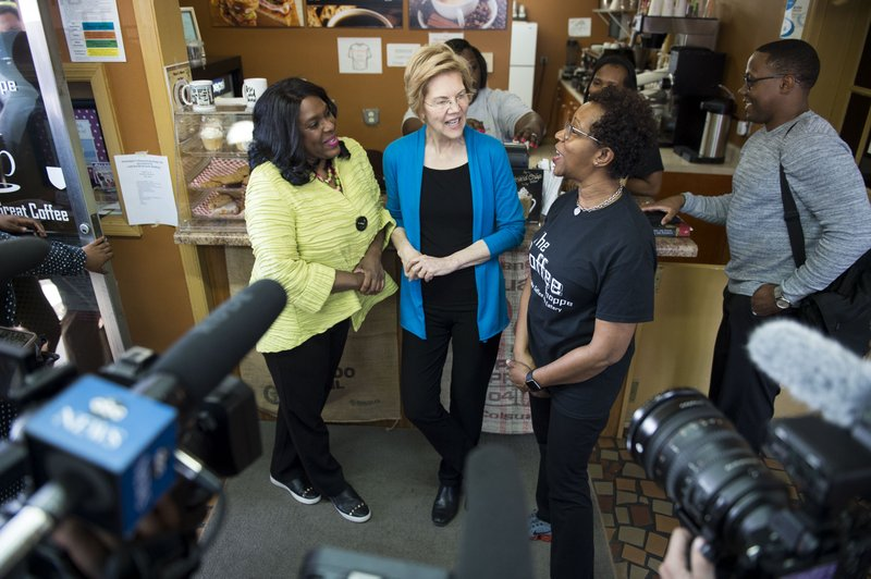 Rep Terri Sewell, left, and Democratic presidential candidate Sen. Elizabeth Warren, D-Mass., talk with Coffee Shoppe owner Jackie Smith in Selma, Ala. (Jake Crandall/The Montgomery Advertiser via AP)