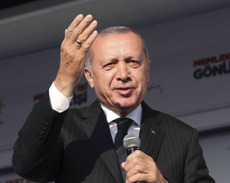 Turkey's President Recep Tayyip Erdogan salutes the supporters of his ruling Justice and Development Party during a rally in Kocaeli, Turkey, Tuesday, March 19, 2019. (Presidential Press Service via AP, Pool)