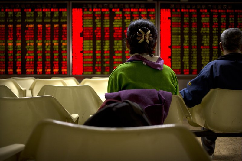 Chinese investors monitor stock prices at a brokerage house in Beijing, Wednesday, March 20, 2019. Markets in Asia are mostly lower after a lackluster day of trading on Wall Street.(AP Photo/Mark Schiefelbein)
