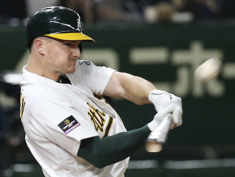 Oakland Athletics's Matt Chapman hits a three-run home run off Seattle Mariners pitcher Nick Rumbelow in the seventh inning of Game 1 of their Major League opening series baseball game at Tokyo Dome in Tokyo, Wednesday, March 20, 2019. (AP Photo/Koji Sasahara)