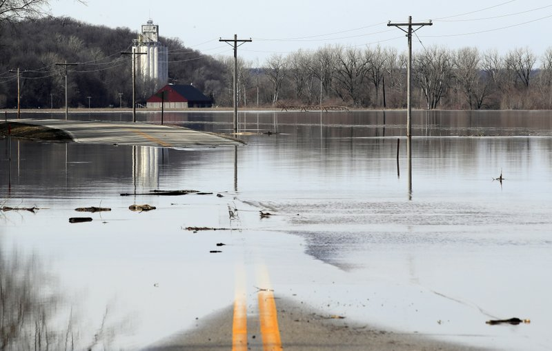 The Missouri River floods across and closes K-7 highway near White Cloud, Kan., Monday, March 18, 2019. (AP Photo/Orlin Wagner)