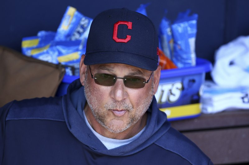 FILE - In this Monday, March 4, 2019, file photo, Cleveland Indians manager Terry Francona sits in the dugout before a spring training baseball game against the San Diego Padres in Peoria, Ariz. (AP Photo/Ross D. Franklin, File)
