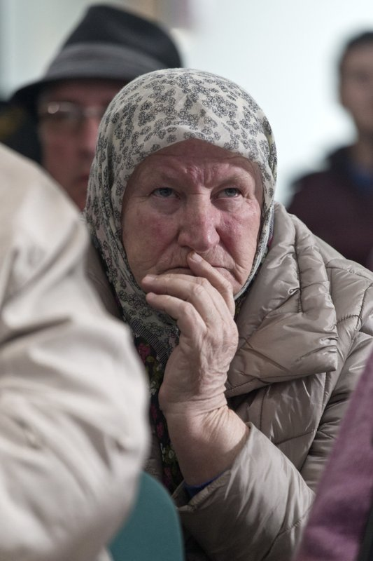 A relative of victims of the Srebrenica genocide awaits the decision of the UN appeals judges on former Bosnian Serb leader Radovan Karadzic in Potocari, Bosnia and Herzegovina, Wednesday, March 20, 2019. (AP Photo/Marko Drobnjakovic)