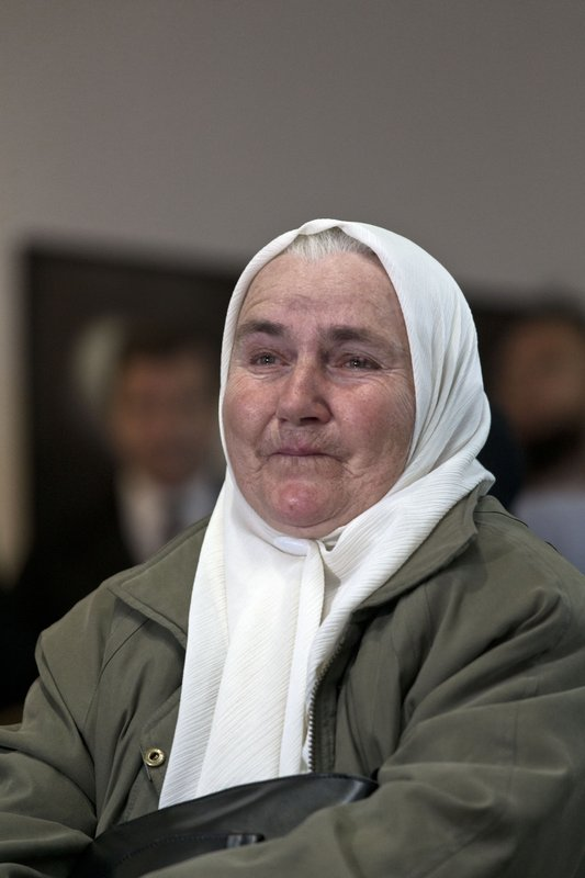 A relative of victims of the Srebrenica genocide cries as she hears the news on the decision of the UN appeals judges on former Bosnian Serb leader Radovan Karadzic in Potocari, Bosnia and Herzegovina, Wednesday, March 20, 2019. (AP Photo/Marko Drobnjakovic)