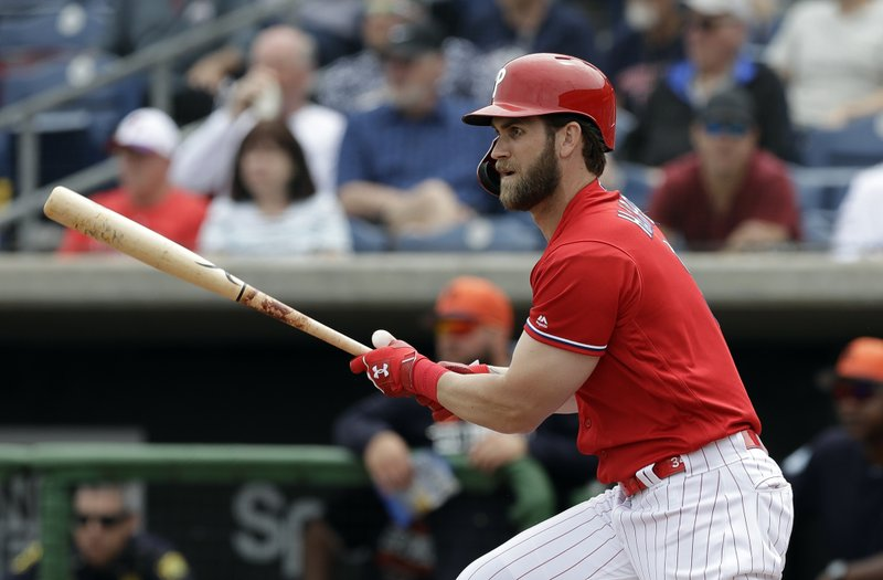 Philadelphia Phillies' Bryce Harper watches his single off Detroit Tigers starting pitcher Spencer Turnbull during the fourth inning of a spring training baseball game Wednesday, March 20, 2019, in Clearwater, Fla. (AP Photo/Chris O'Meara)