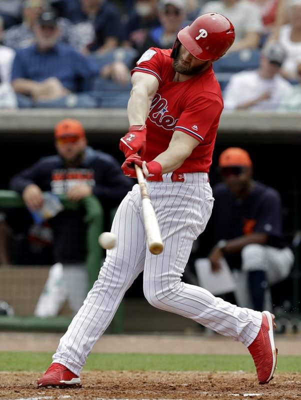 Philadelphia Phillies' Bryce Harper lines a single off Detroit Tigers starting pitcher Spencer Turnbull during the fourth inning of a spring training baseball game Wednesday, March 20, 2019, in Clearwater, Fla. (AP Photo/Chris O'Meara)