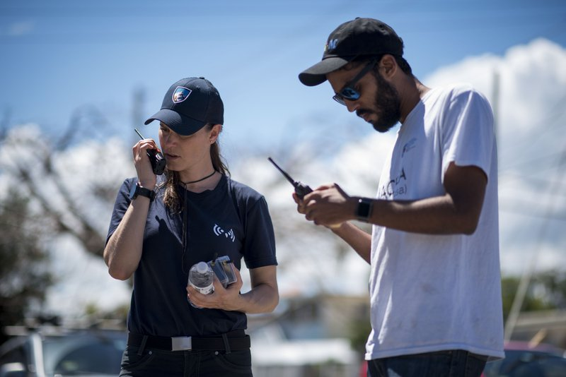 In this March 13, 2019 photo, self-taught Puerto Rican tech developer Pedro Cruz, right, and Maria M. (AP Photo/Carlos Giusti)