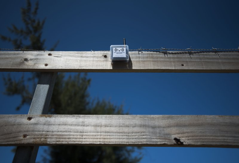 This March 13, 2019 photo shows a transmitter that is part of a system that provides a low-frequency Wi-Fi connection, affixed to the slat of a wooden fence, during a field test in Isabela, Puerto Rico. (AP Photo/Carlos Giusti)