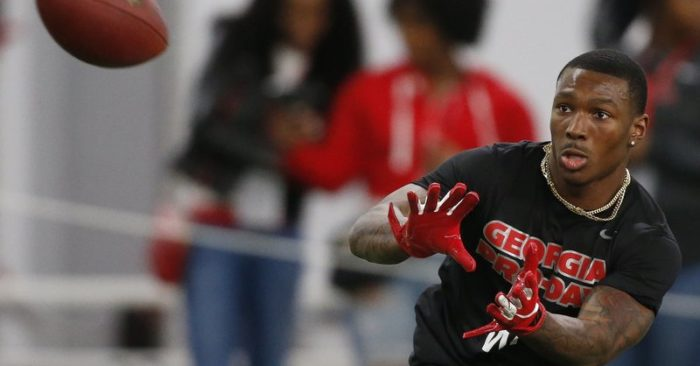 210e7e085fb Georgia wide receiver Mecole Hardman (4) reaches for a pass during Pro Day  at the University of Georgia, Wednesday, March 20, 2019, in Athens, Ga.