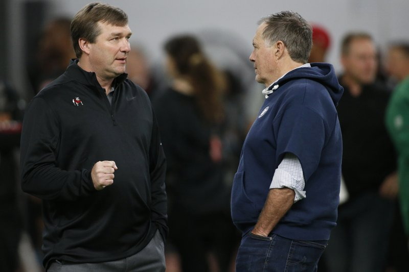 Georgia coach Kirby Smart speaks with New England Patriots head coach Bill Belichick during Pro Day at the University of Georgia, Wednesday, March 20, 2019, in Athens, Ga. (Joshua L. Jones/Athens Banner-Herald via AP)