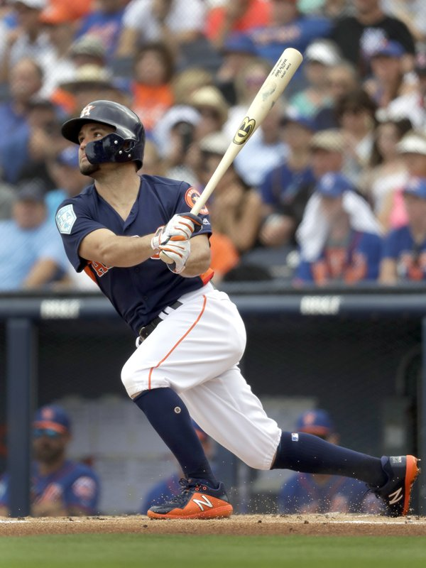 FILE - In this Feb. 25, 2019, file photo, Houston Astros' Jose Altuve lines out during the first inning of an exhibition spring training baseball game against the New York Mets in West Palm Beach, Fla. (AP Photo/Jeff Roberson, File)