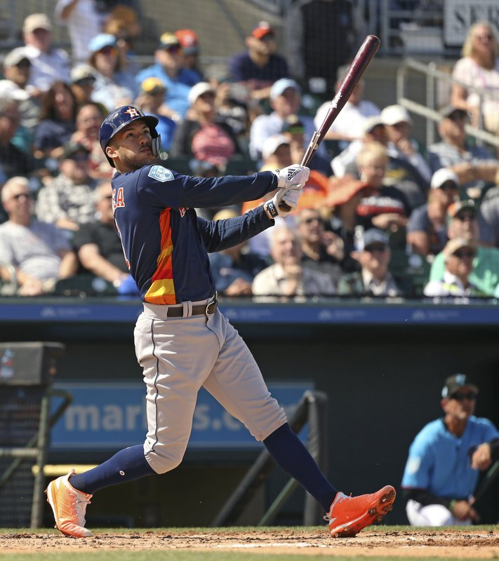 FILE - In this Thursday, March 7, 2019, file photo, Houston Astros' Carlos Correa follows through on a foul ball during the third inning of a spring training baseball game against the Miami Marlins at the Roger Dean Chevrolet Stadium on in Jupiter, Fla.(David Santiago/Miami Herald via AP, File)