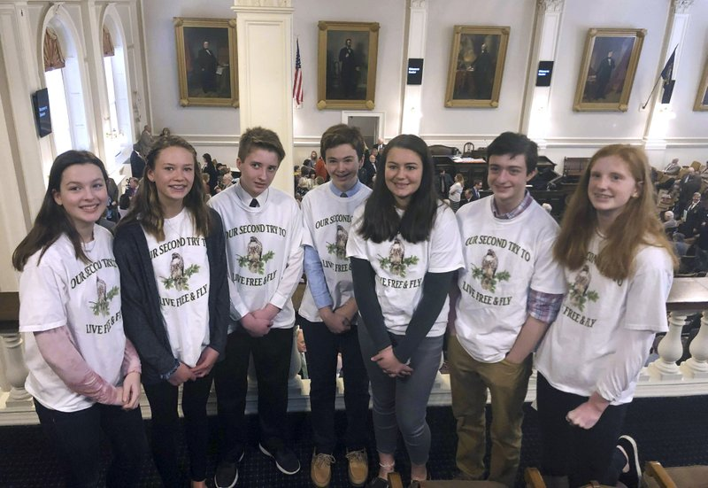 Eighth graders from Hampton Falls, N.H. stand in the gallery of the New Hampshire House on Wednesday, March 20, 2019, in Concord, N. (AP Photo/Holly Ramer)