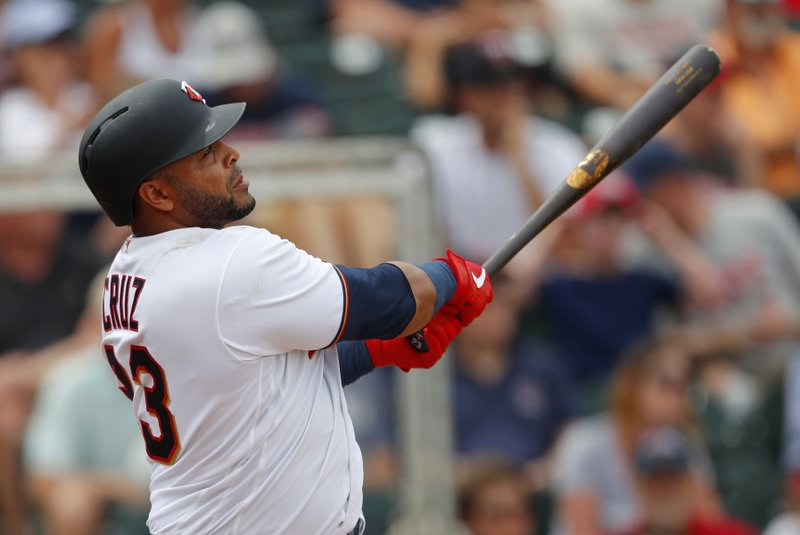 FILE - In this Monday, March 18, 2019, file photo, Minnesota Twins designated hitter Nelson Cruz drives in a run with a double in the fifth inning of a spring training baseball game against the Boston Red Sox in Fort Myers, Fla. (AP Photo/John Bazemore, File)