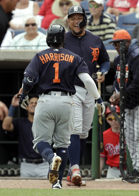 Detroit Tigers' Josh Harrison (1) celebrates with Miguel Cabrera after Harrison hit a home run off Philadelphia Phillies starting pitcher Nick Pivetta during the third inning of a spring training baseball game Wednesday, March 20, 2019, in Clearwater, Fla. (AP Photo/Chris O'Meara)