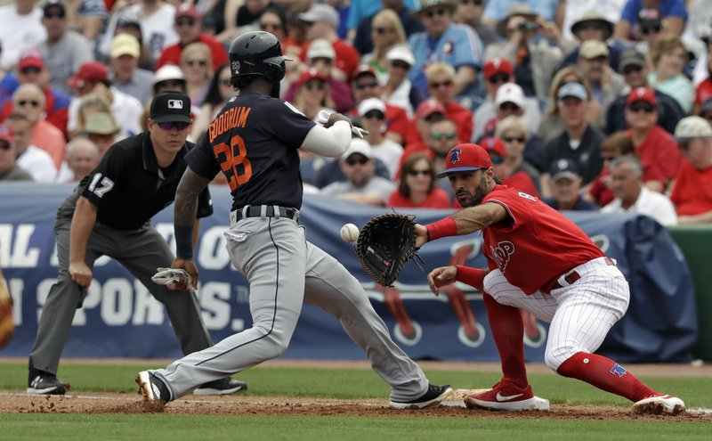 Detroit Tigers' Niko Goodrum (28) gets back ahead of the throw to Philadelphia Phillies first baseman Sean Rodriguez on a pickoff attempt during the fourth inning of a spring training baseball game Wednesday, March 20, 2019, in Clearwater, Fla. (AP Photo/Chris O'Meara)