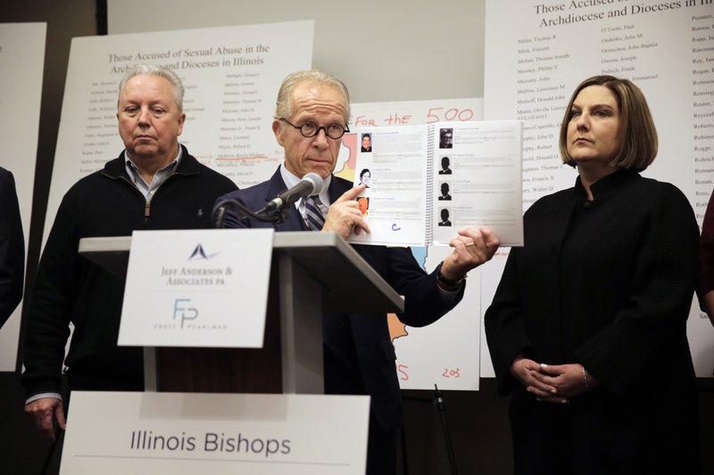 Attorney Jeff Anderson speaks as Joe Iacono, left, and Cindy Yesko listen during a news conference with , Wednesday, March 20, 2019, in Chicago. (AP Photo/Kiichiro Sato)