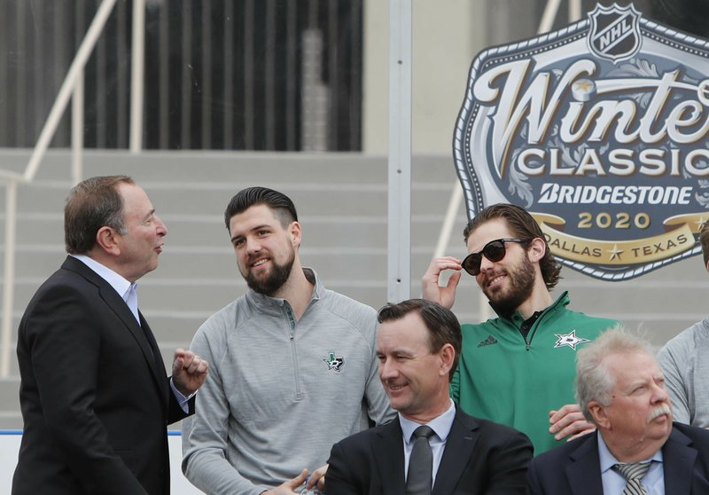 NHL commissioner Gary Bettman, left, chats with Dallas Stars Jamie Benn, center, and Tyler Seguin during a news conference outside the Cotton Bowl in Dallas, Wednesday, March 20, 2019. (AP Photo/LM Otero)