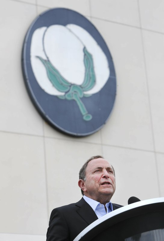 NHL commissioner Gary Bettman speaks from the podium during a news conference outside the Cotton Bowl in Dallas, Wednesday, March 20, 2019. (AP Photo/LM Otero)