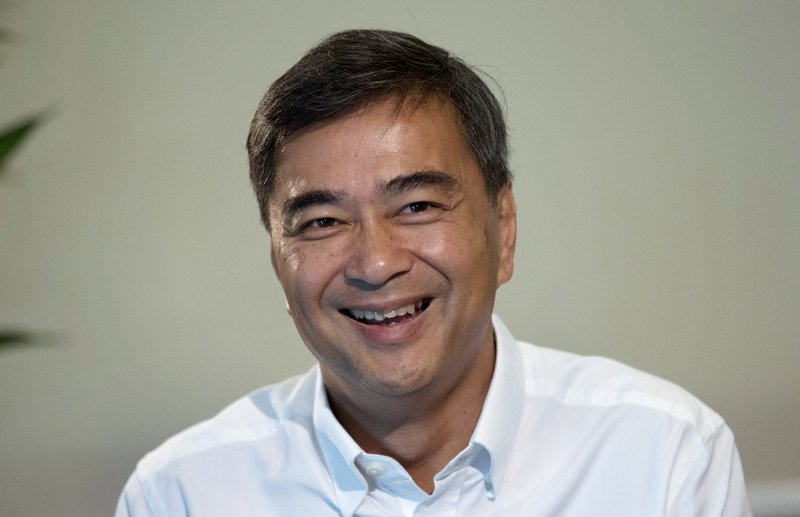 The leader of Thailand's Democrat Party Abhisit Vejjajiva talks to The Associated Press reporters during an interview Wednesday, March 20, 2019. (AP Photo/Sakchai Lalit)