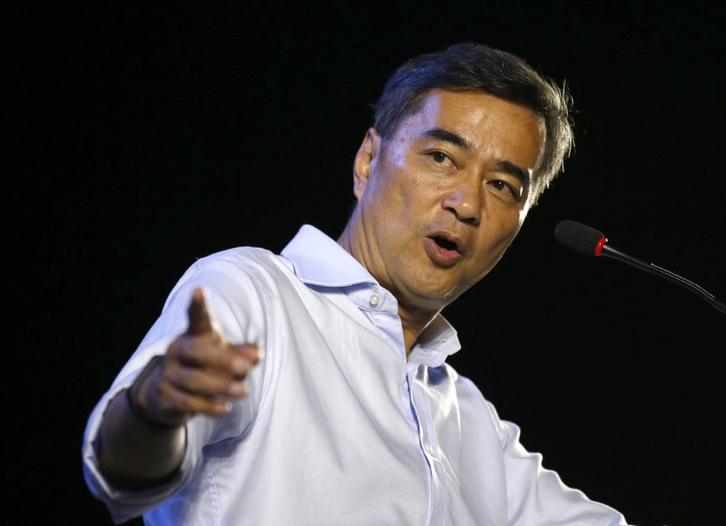 In this Monday, March 18, 2019, photo, the leader of Thailand's Democrat Party Abhisit Vejjajiva delivers a speech to supporters during an election campaign in Bangkok, Thailand, Abhisit says if he becomes prime minister after Sunday's election, he'll make careful but forceful efforts to undo undemocratic constitutional clauses imposed by the military government that took power in 2014. (AP Photo/Sakchai Lalit)