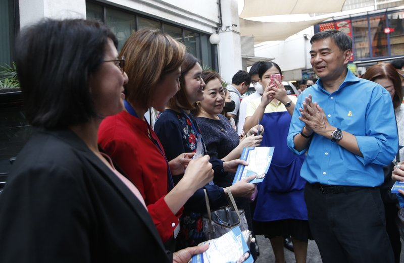 In this Tuesday, Jan. 29, 2019. the leader of Thailand's Democrat Party Abhisit Vejjajiva, right, gives the traditional greeting or