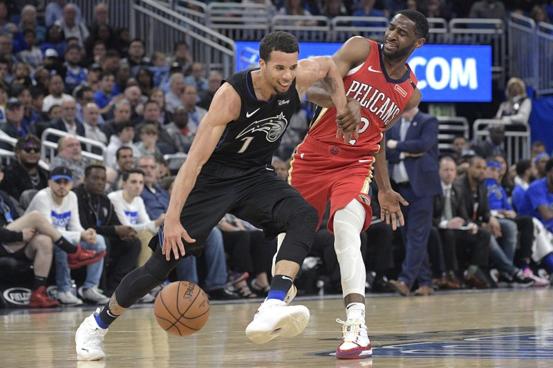 Orlando Magic guard Michael Carter-Williams (7) is fouled by New Orleans Pelicans guard Ian Clark (2) while pushing the ball up the court during the second half of an NBA basketball game Wednesday, March 20, 2019, in Orlando, Fla. (AP Photo/Phelan M. Ebenhack)