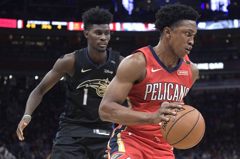 New Orleans Pelicans forward Stanley Johnson, right, drives past Orlando Magic forward Jonathan Isaac during the first half of an NBA basketball game Wednesday, March 20, 2019, in Orlando, Fla. (AP Photo/Phelan M. Ebenhack)