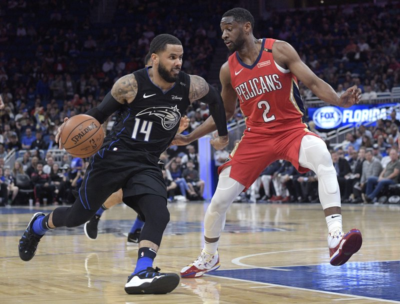 Orlando Magic guard D.J. Augustin (14) drives to the basket in front of New Orleans Pelicans guard Ian Clark (2) during the first half of an NBA basketball game Wednesday, March 20, 2019, in Orlando, Fla. (AP Photo/Phelan M. Ebenhack)