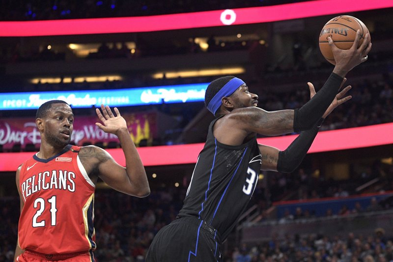 Orlando Magic guard Terrence Ross (31) shoots next to New Orleans Pelicans forward Darius Miller (21) during the first half of an NBA basketball game Wednesday, March 20, 2019, in Orlando, Fla. (AP Photo/Phelan M. Ebenhack)