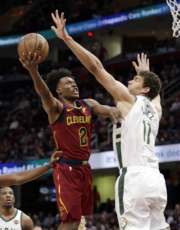 Cleveland Cavaliers' Collin Sexton (2) drives to the basket against Milwaukee Bucks' Brook Lopez (11) during the first half of an NBA basketball game Wednesday, March 20, 2019, in Cleveland. (AP Photo/Tony Dejak)