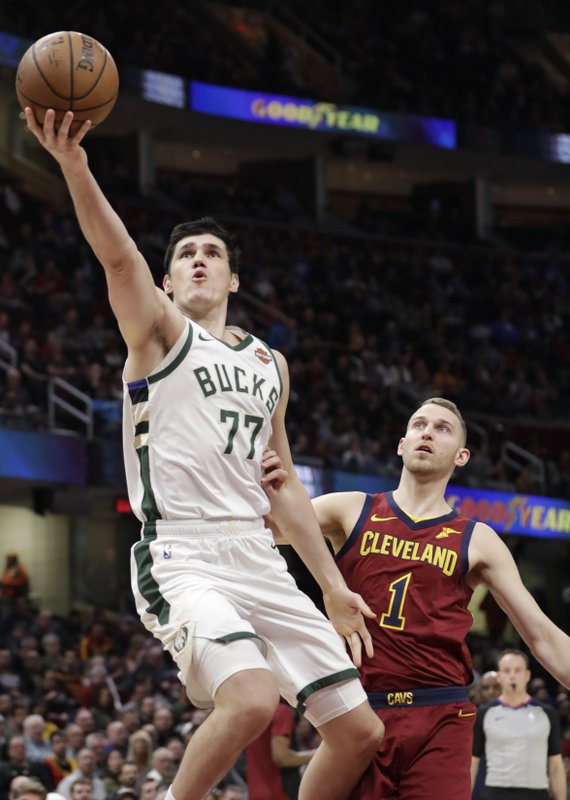 Milwaukee Bucks' Ersan Ilyasova (77) drives to the basket against Cleveland Cavaliers' Nik Stauskas (1) during the first half of an NBA basketball game Wednesday, March 20, 2019, in Cleveland. (AP Photo/Tony Dejak)