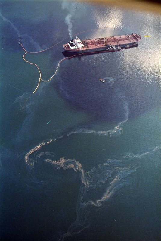 FILE - In this April 9, 1989, file photo, crude oil from the tanker Exxon Valdez, top, swirls on the surface of Alaska's Prince William Sound near Naked Island, days after the tanker ran aground, spilling millions of gallons of oil and causing widespread environmental damage. (AP Photo/John Gaps III, File)