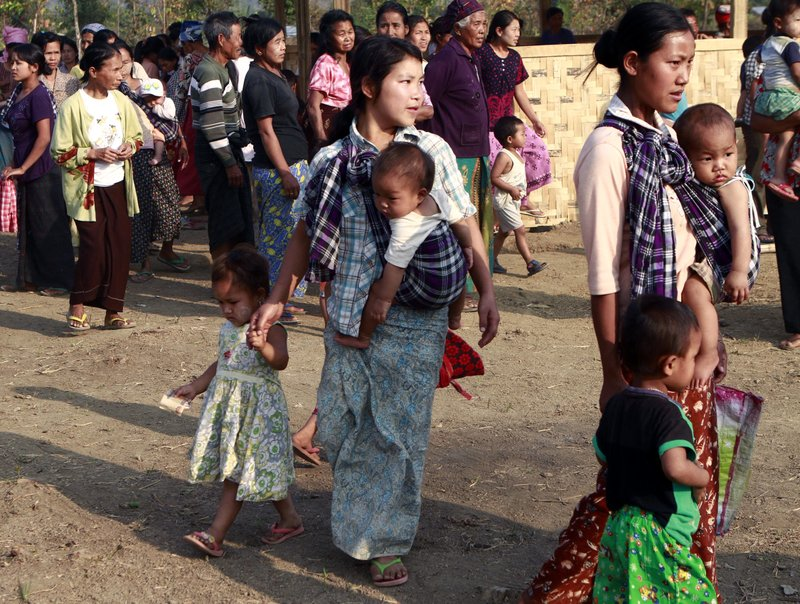 In this Feb. 22, 2012, photo, refugee women with children gather in their refugee camp in Myitkyina, Kachin state, northern Myanmar. (AP Photo/Khin Maung Win, File)