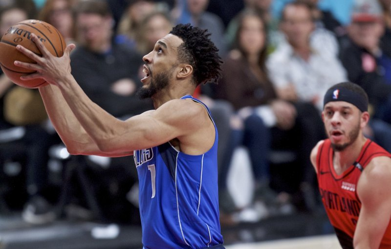 Dallas Mavericks guard Courtney Lee, left, shoots in front of Portland Trail Blazers guard Seth Curry during the first half of an NBA basketball game in Portland, Ore. (AP Photo/Craig Mitchelldyer)
