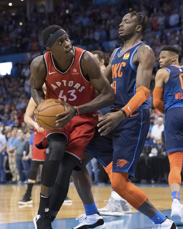 Toronto Raptors forward Pascal Siakam (43) bumps against Oklahoma City Thunder forward Jerami Grant (9) during the first half of an NBA basketball game Wednesday, March 20, 2019, in Oklahoma City. (AP Photo/Rob Ferguson)