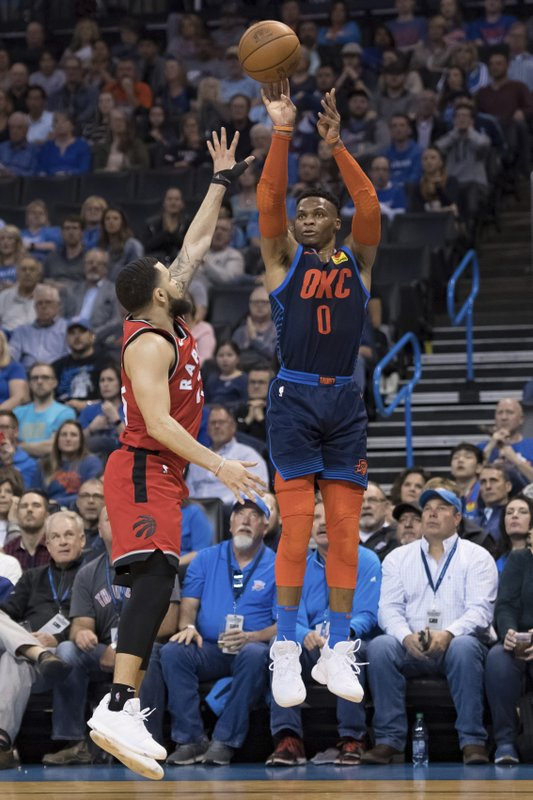 Oklahoma City Thunder guard Russell Westbrook (0) shoots a 3=point basket over Toronto Raptors guard Fred VanVleet (23) during the second half of an NBA basketball game Wednesday, March 20, 2019, in Oklahoma City. (AP Photo/Rob Ferguson)